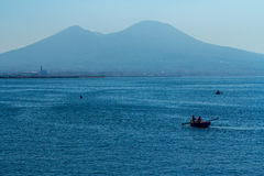 Boat in city of Naples with Mount Vesuvius Royalty Free Stock Photography