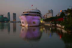 Boat from the city promenade in the evening twilight. Tourist terminal DHS-marina. Danang Royalty Free Stock Images