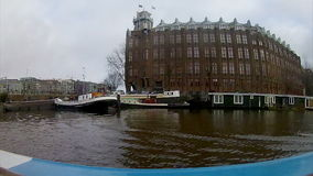Boat city tour time-lapse in canals of Amsterdam stock video