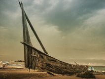 A boat. Classic wooden boat on the beach waiting for the right time for fishery Stock Photos