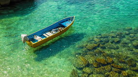 Boat on clear sea. Fishing boat on clear turquoise sea stock video