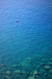 Boat in clear water. Boat in deep blue water view from above Stock Images