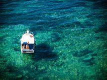 Boat in the clear water Stock Photos