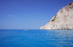 Boat at cliff face on Zakynthos island Royalty Free Stock Image