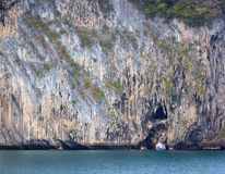 Boat and cliff. Boat in front of the cliff3 Royalty Free Stock Photo