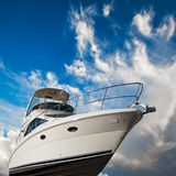 Boat with clipping path. Boat at a  low angle perspective with a picturesque cloudy blue sky in the background. This image contains a clipping path for the boat Stock Photos