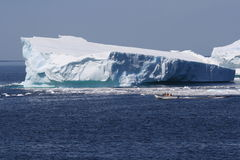 Boat Close to Iceberg in Goose Cove Royalty Free Stock Photos