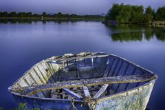 Boat close up at early morning on the lake. royalty free stock image