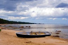 Boat on the coast. The old boat on the Baltic sea coast Royalty Free Stock Images