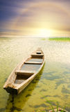 Boat at coast against asunset. Stock Images