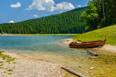 Boat on the coast of Black Lake. Crno jezero in Durmitor National Park, Montenegro Royalty Free Stock Photography
