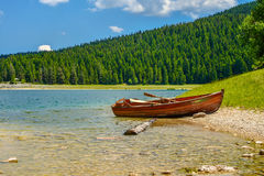 Boat on the coast of Black Lake. Crno jezero in Durmitor National Park, Montenegro Royalty Free Stock Images