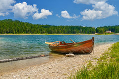 Boat on the coast of Black Lake. Crno jezero in Durmitor National Park, Montenegro Stock Image