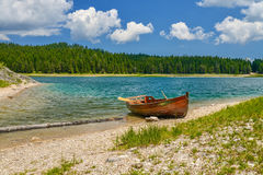 Boat on the coast of Black Lake. Crno jezero in Durmitor National Park, Montenegro Stock Photo