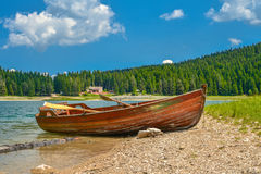 Boat on the coast of Black Lake. Crno jezero in Durmitor National Park, Montenegro Stock Photos