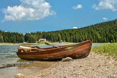 Boat on the coast of Black Lake. Crno jezero in Durmitor National Park, Montenegro Stock Photography