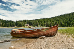 Boat on the coast of Black Lake. Crno jezero in Durmitor National Park, Montenegro Stock Images