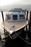 Boat on the coast of Orta lake stock images