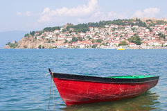 Boat with coast town in background Royalty Free Stock Images