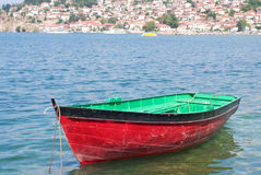 Boat with coast town in background Royalty Free Stock Photography
