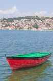 Boat with coast town in background Stock Image