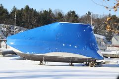 Boat with Shrink Wrap. Boat with a coat of shrink-wrap , protection from winter elements in North America Stock Photos