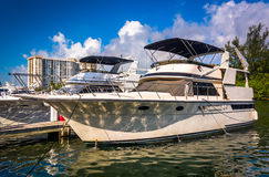 Boat in Collins Canal in Miami Beach, Florida. Stock Photo