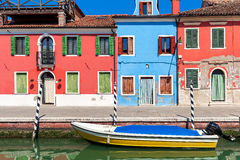 Boat and colorful houses of Burano, Italy. Stock Image