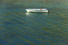 Boat in colorful water, Greenland Royalty Free Stock Image
