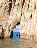 Boat coming through a crevice stock photos
