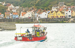 A boat coming into Staithes harbor. Royalty Free Stock Photo