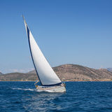 Boat competitor of sailing regatta. Royalty Free Stock Photo