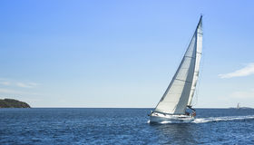 Boat competitor of sailing regatta in clear weather. Stock Image
