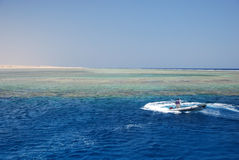 Boat on coral reef Royalty Free Stock Photo