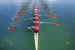 Boat coxed eight Rowers rowing. On the blue lake Stock Images