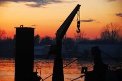 Boat cran and sunset at Sava river Stock Images