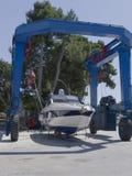 Boat on crane. Boat in maintenance in Novigrad marina, Croatia Royalty Free Stock Photo