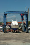 Boat on crane Royalty Free Stock Image