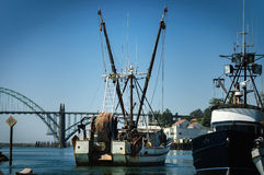 Boat crane. Fishermen boat crane in Newport, Oregon, USA Royalty Free Stock Images