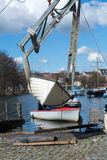 Boat crane lifts the boat into the water Royalty Free Stock Photography