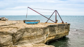 Boat Crane. Located on the rocks by the sea. Used to lower and lift boats in and out of the sea Royalty Free Stock Image