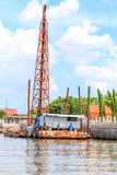 Boat crane . Boat crane nailed to a pole in the water Stock Photo