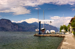 Boat crane on the shores of the Lake near Brenzone Stock Photography