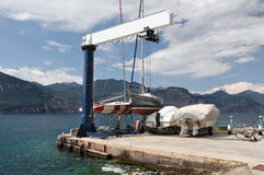 Boat crane on the shores of the Lake near Brenzone Stock Image
