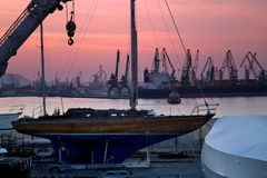 Boat, cranes,wharf and  purplish sky Royalty Free Stock Photos