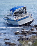 Boat crash. Motorboat crash on rocky shore Royalty Free Stock Images