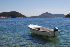 Boat in the Croatian Adriatic. Boat docked in Croatia with island mountains in the background stock photography