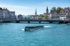 Boat crosses the river in downtown Zurich, Switzerland stock image