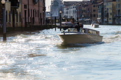 Boat crossing the Grand canal in Venice Stock Photos