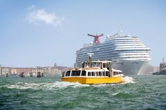 Boat and Cruise Ship in Venice lagoon Stock Photo